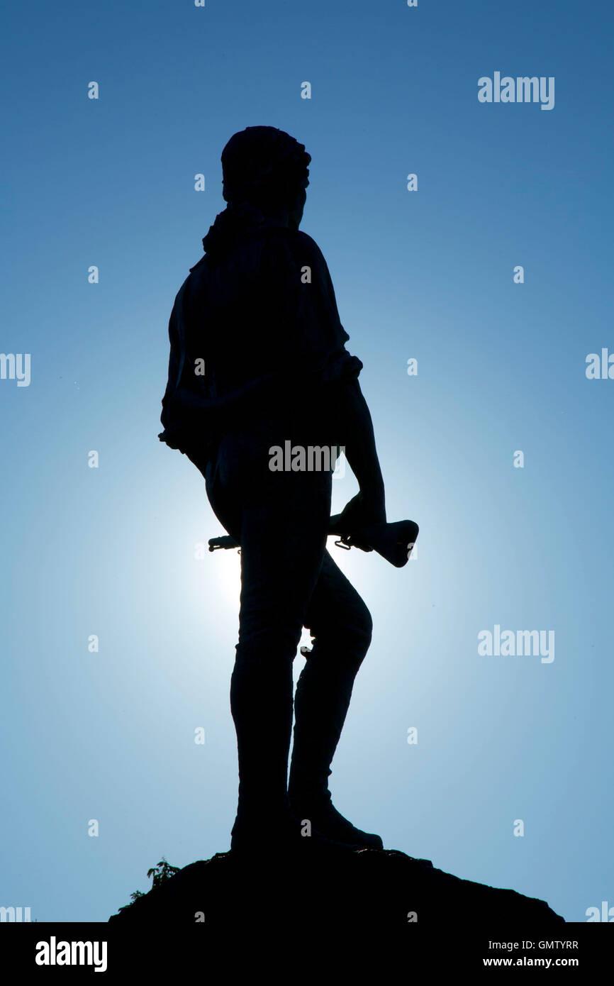 Captain Parker statue on Battle Green in silhouette, Lexington Green, Lexington,  Massachusetts Stock Photo
