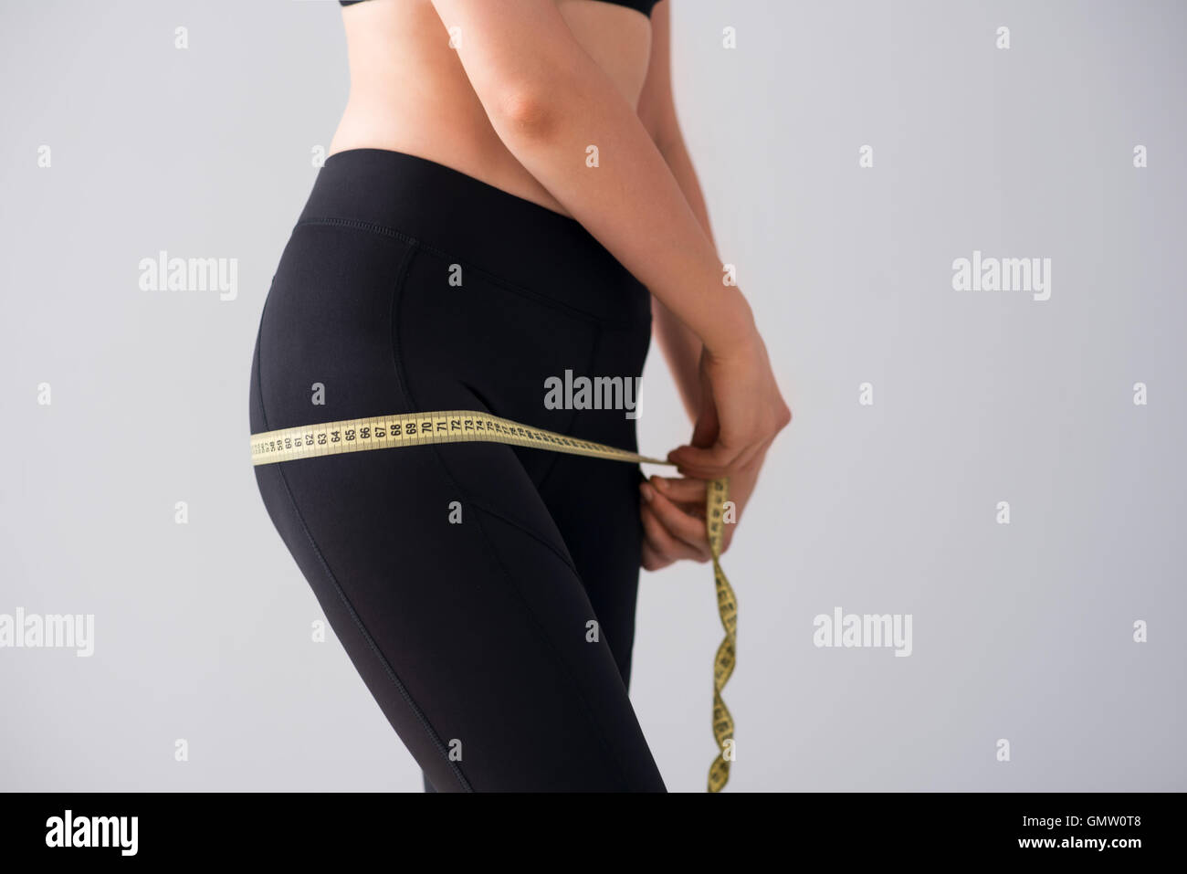 Young woman with centimeter - Stock Image
