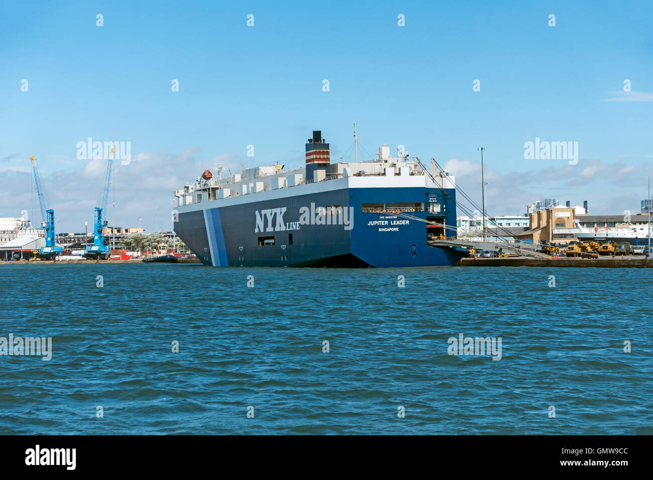 NYK Line Jupiter Leader loading vehicle equipment in Southampton harbour port Southampton Hampshire England - Stock Image