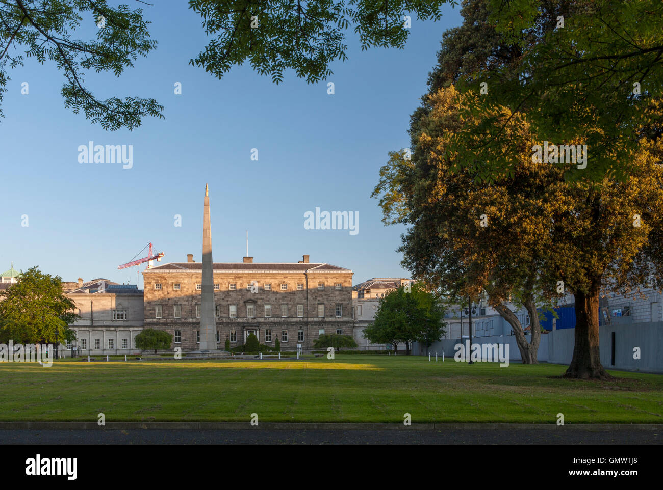 Dublin's Leinster House is home to the Irish parliament or Oireachtas Éireann with striking sidelighting. Stock Photo