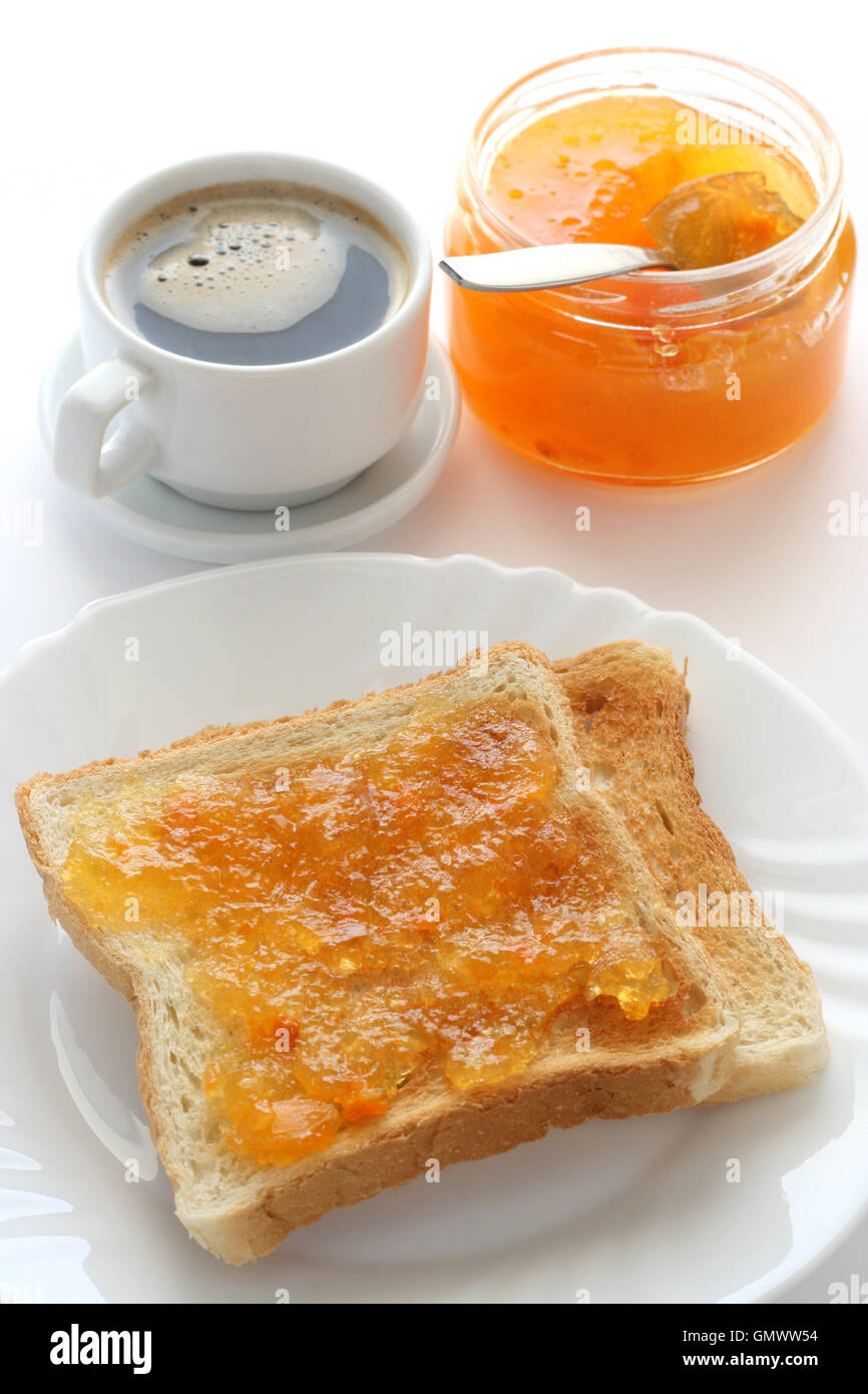 toast with jam and a cup of coffee - Stock Image