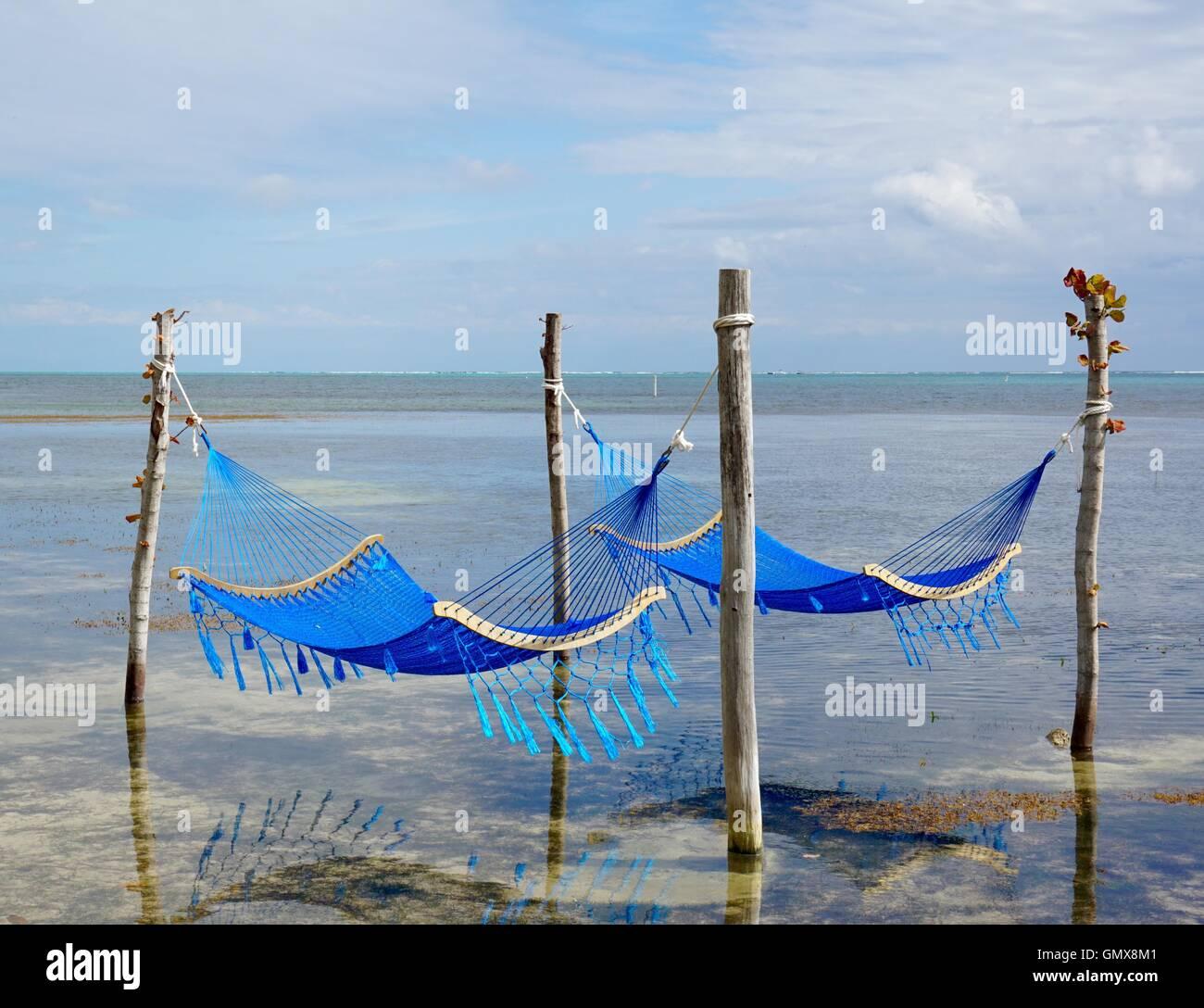 Hammocks in the ocean. Ambergris Caye, Belize. - Stock Image