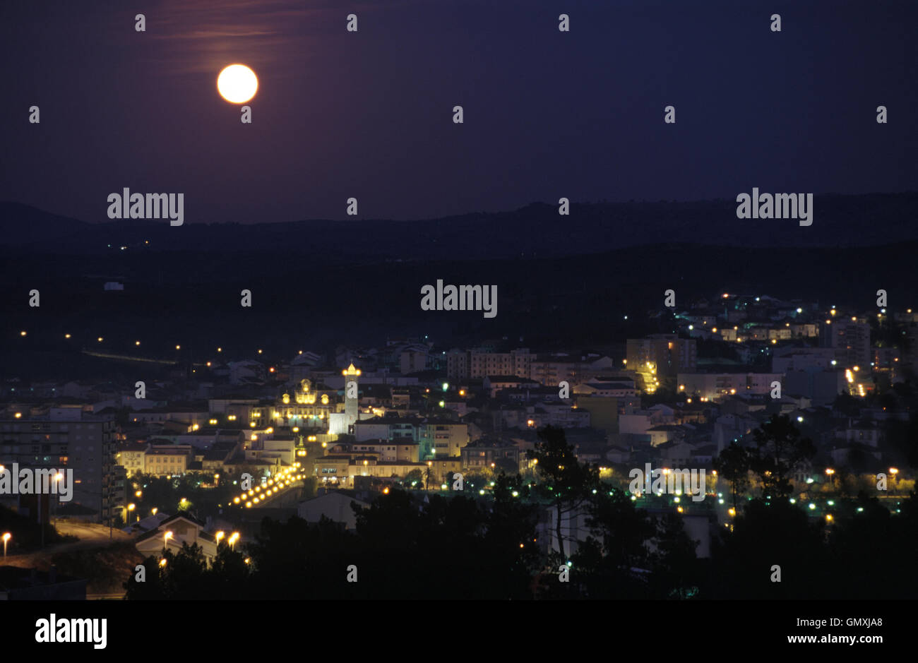 Small town at night with full Moon. North Portugal - Stock Image