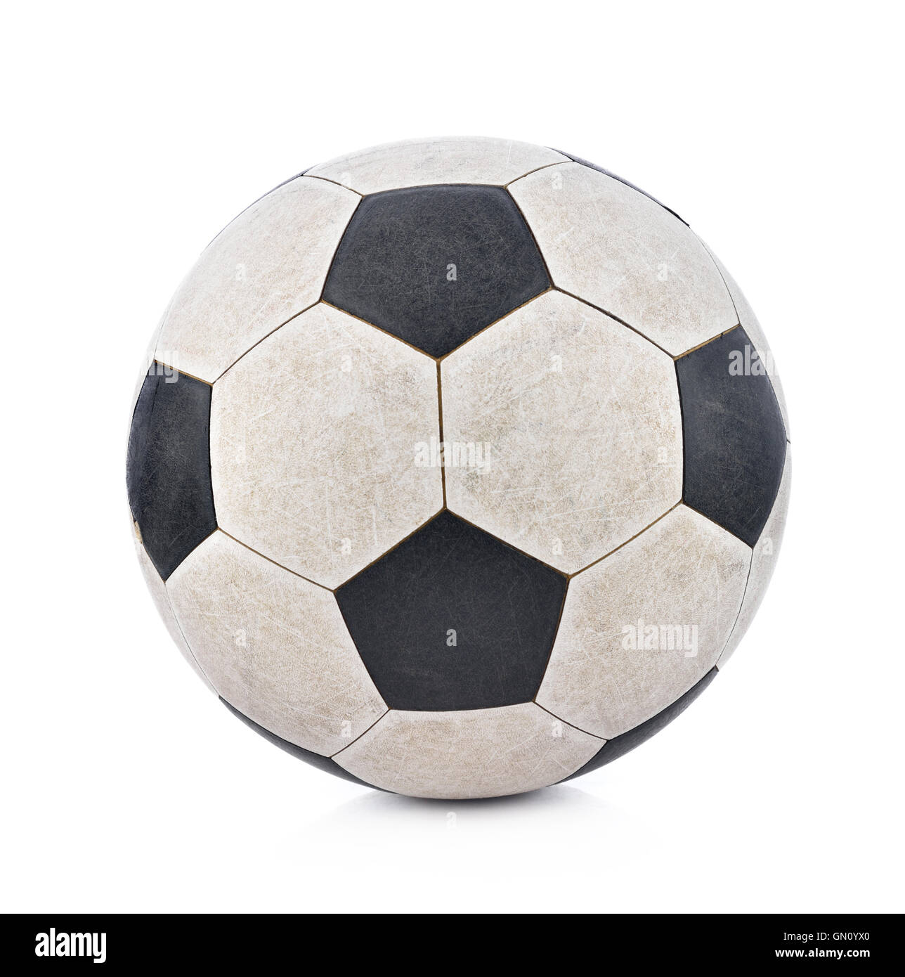 Old soccerball on white background - Stock Image