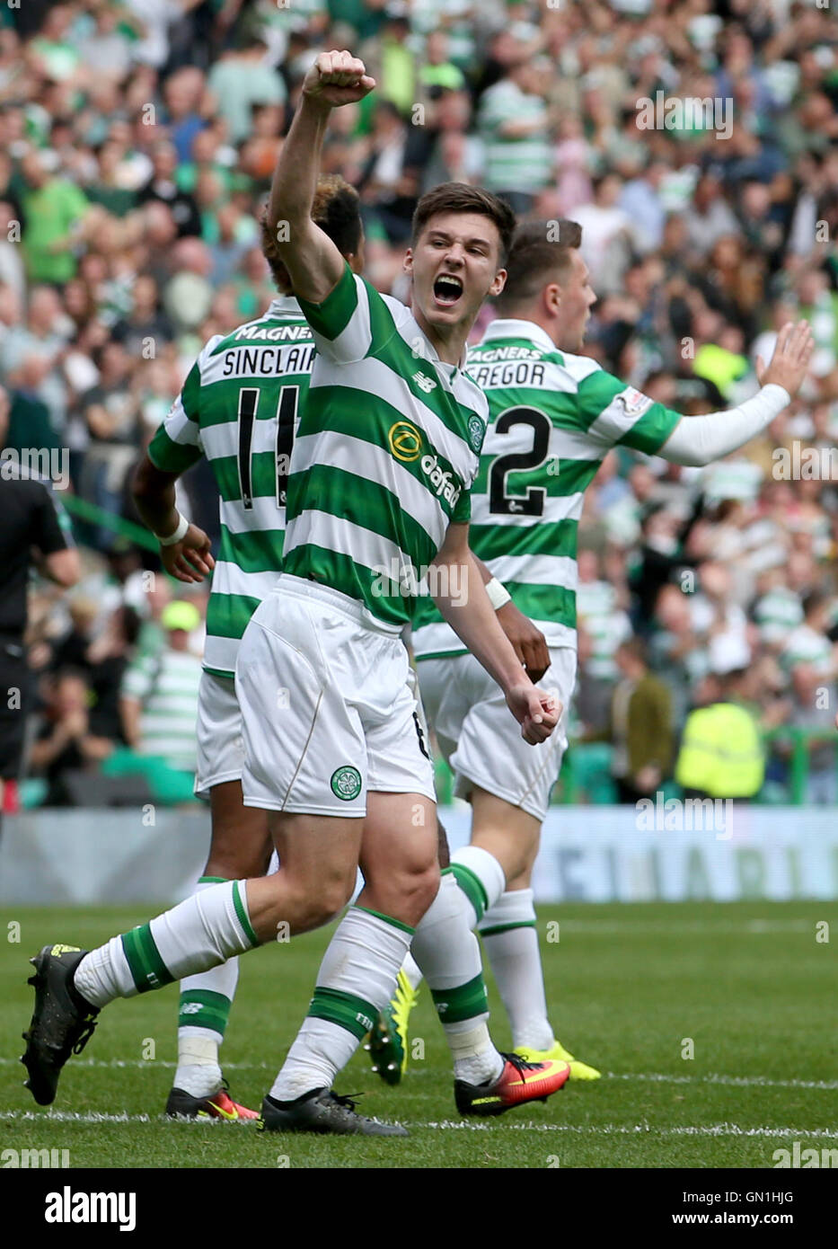 Celtic's Kieran Tierney celebrates team-mate Scott Sinclair scoring his sides third goal from a penalty during - Stock Image