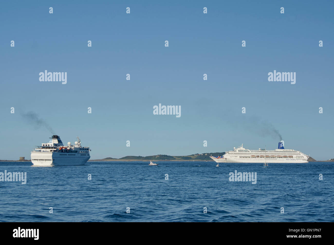 Cruise liners at anchor off St Peter Port Harbour, MV Ventura and P&O Oriana - Stock Image