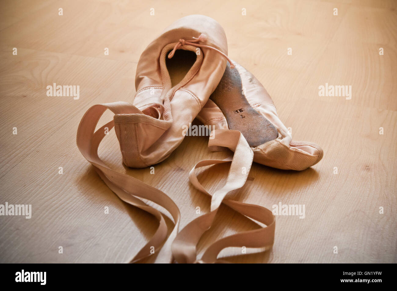 worn out ballet shoes - Stock Image