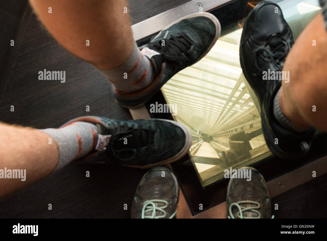 CN Tower, Toronto, Canada - glass window on floor of elevator lift - Stock Image
