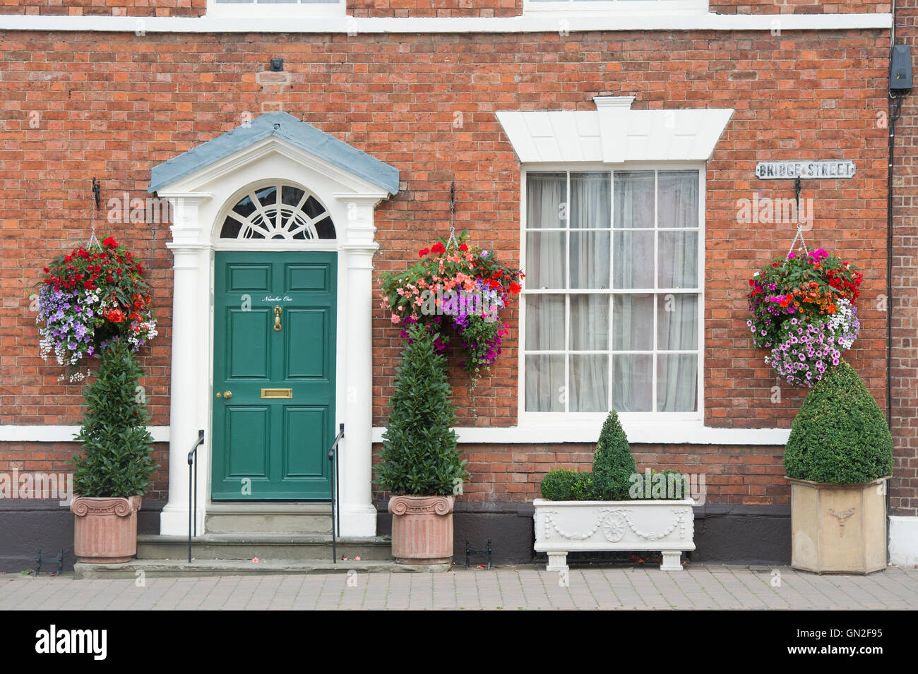 Tremendous Hanging Baskets Of Flowers On A House Exterior In The Town Of Stock Photo Alamy Door Handles Collection Dhjemzonderlifede