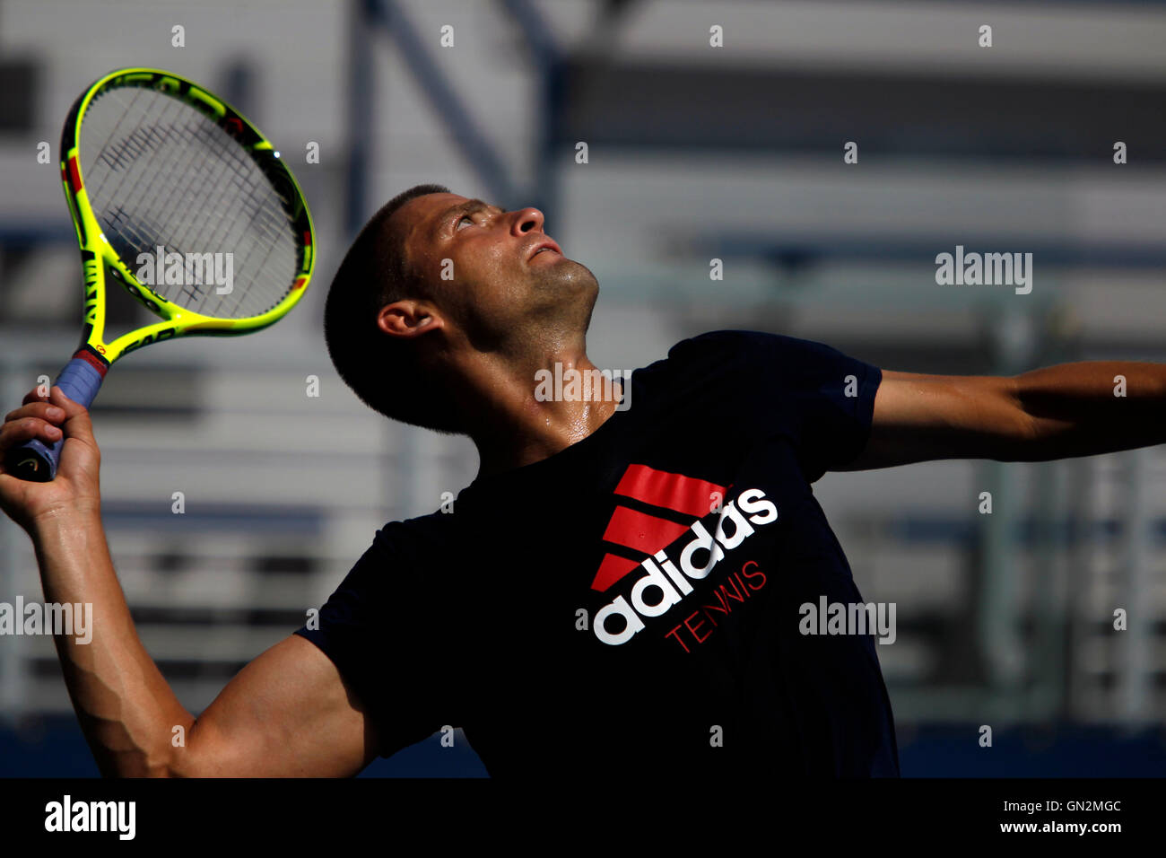 New York, USA. 27th August, 2016. Russia's Mikhail Youzhny serves during a practice session Saturday, August - Stock Image