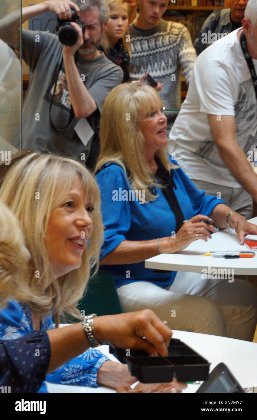 Liverpool, UK. 27th August, 2016. Sister Jenny and Pattie Boyd sign books and photos for Beatles fans at Liverpool - Stock Image