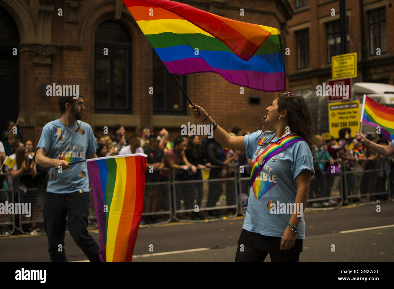 Manchester, UK. 27th August, 2016. Manchester Pride Parade. manchester pride big weekend, woman waves gay pride Stock Photo