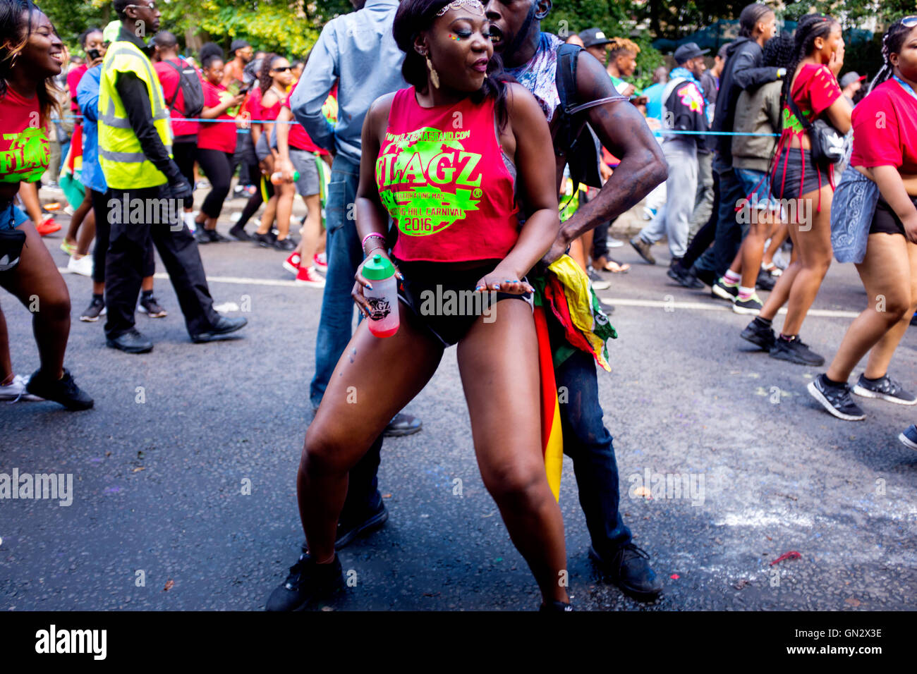 Revelers at the 50th Notting Hill Carnival, London, 2016. Credit:  wayne Tippetts/Alamy Live News - Stock Image