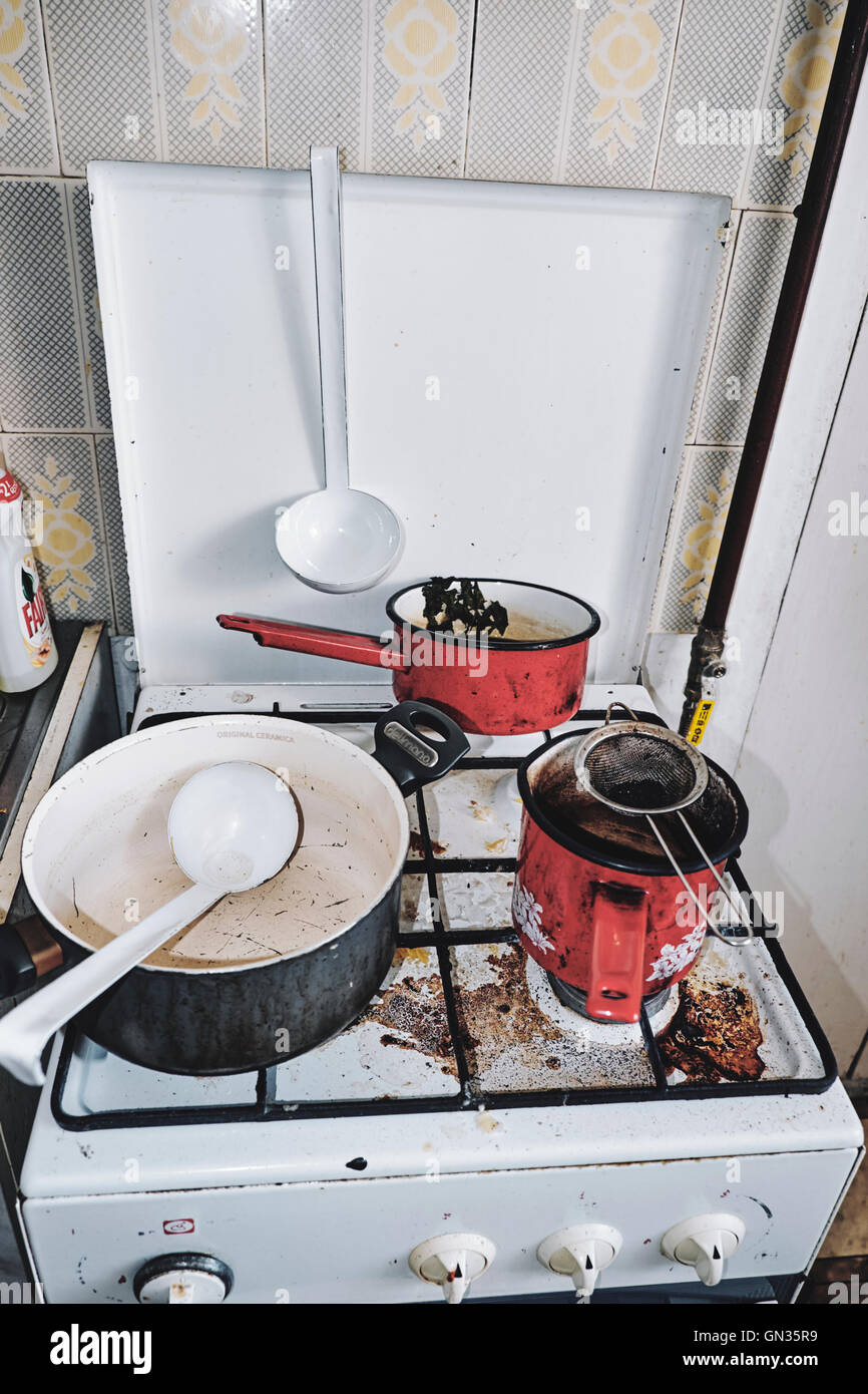 Dirty dishes, gas stove, housework - Stock Image