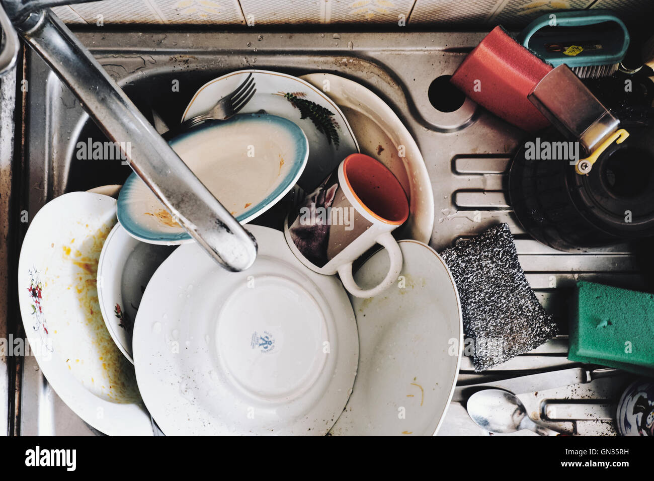 Dirty dishes, kitchen, messy, housework - Stock Image