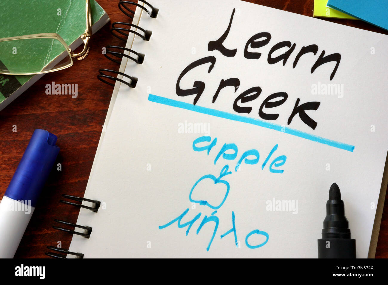 Learn greek written in a notepad.  Education concept. - Stock Image