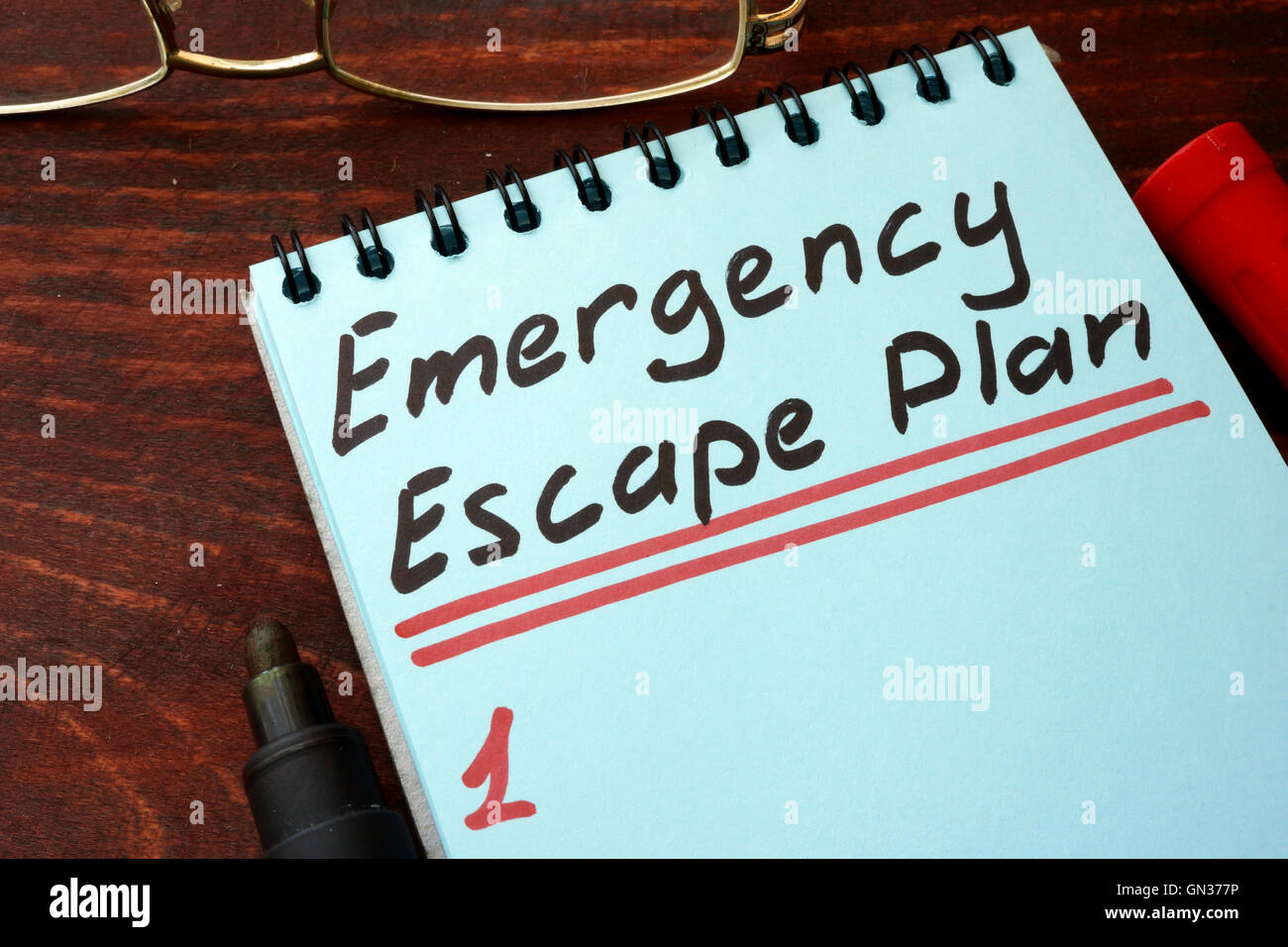 Emergency Escape Plan written on a notepad with marker. - Stock Image