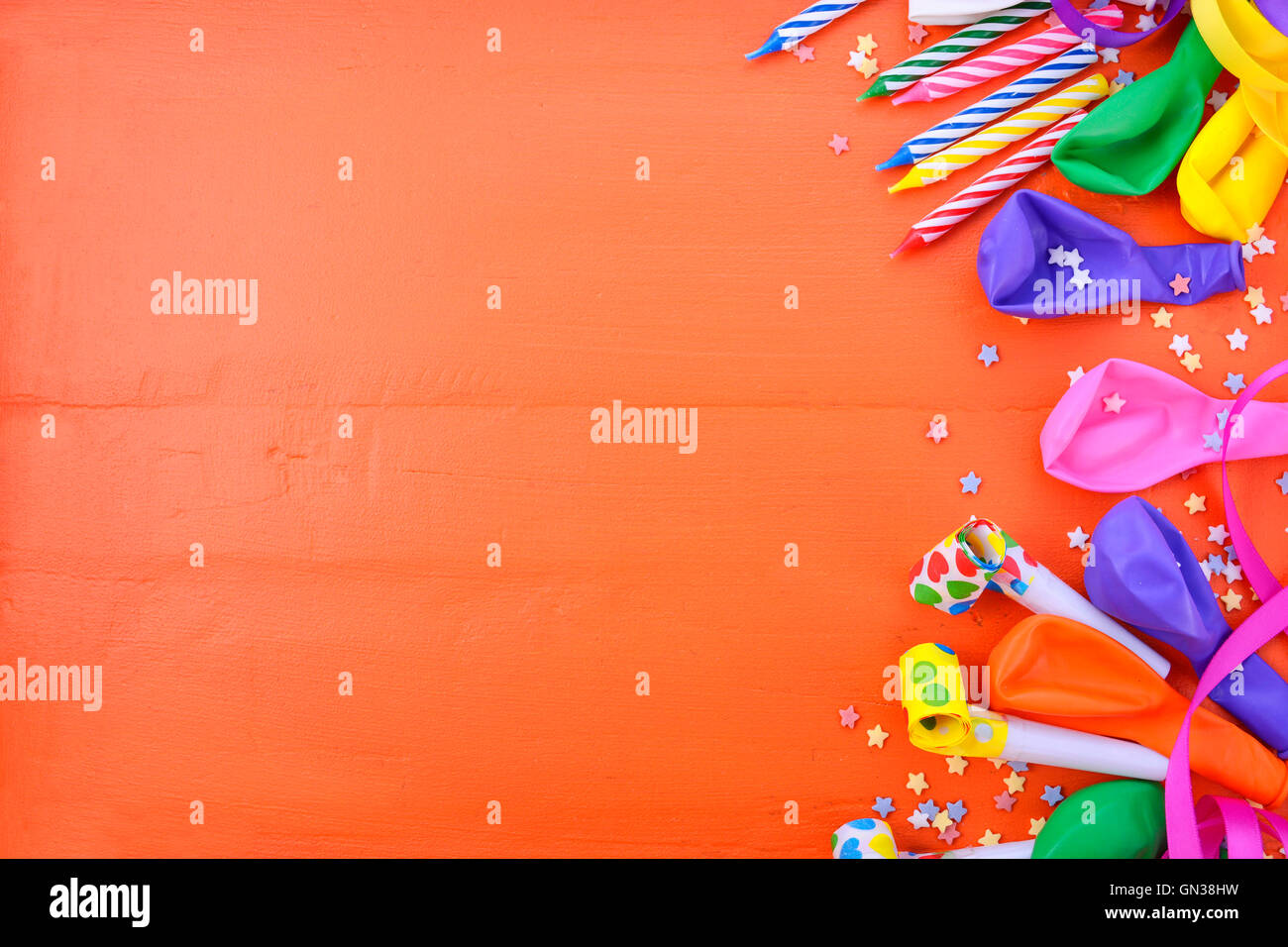 Happy Birthday Background With Decorated Borders Party Decorations On A Bright Orange Wood Table Copy Space For Your T