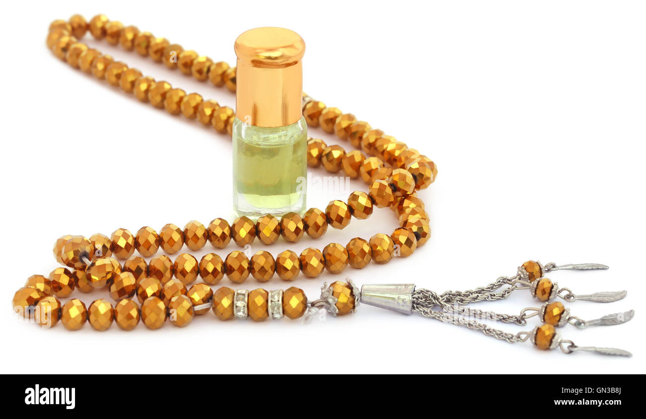 Rosary with perfume that indicates a religious matter - Stock Image