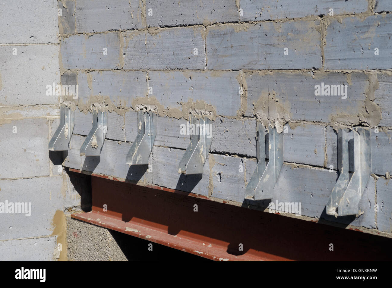 Galvanised joist hangers within interior of house build in progress. - Stock Image