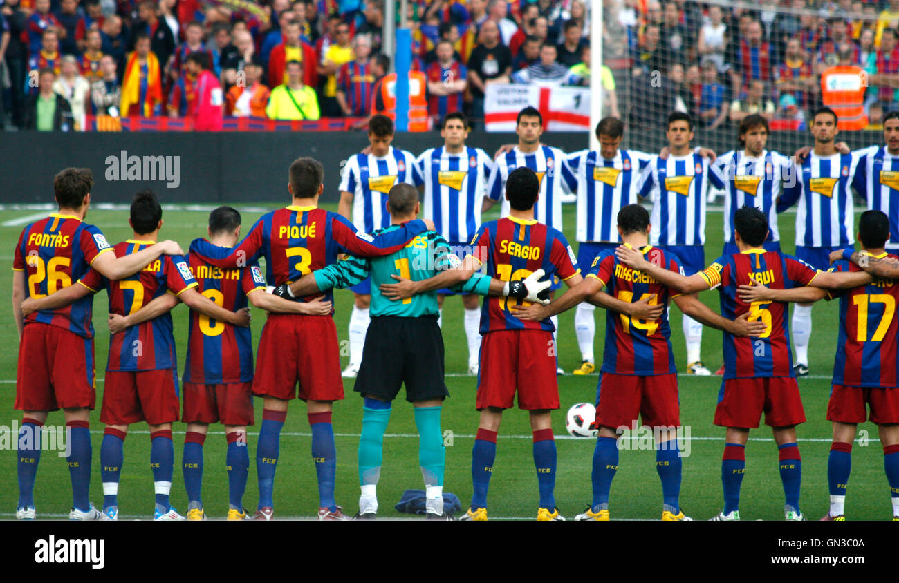 Football teams concentrated before a Spanish League match between FC Barcelona and Espanyol  on Camp Nou, on May Stock Photo