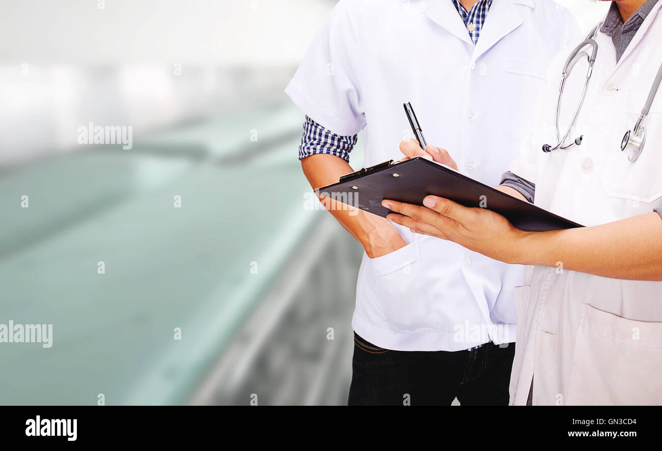 healthcare, uniform, wellbeing,skill, staircase, support,advice, assistance,clipboard, communication,ethnicity, - Stock Image