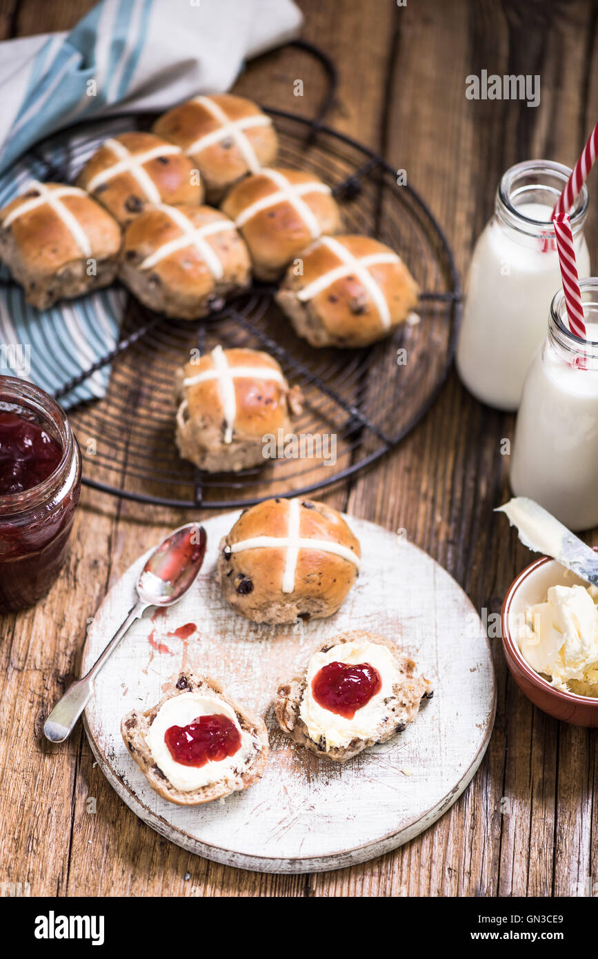 afternoon tea,hot cross bun with strawberry jam and clotted cream - Stock Image