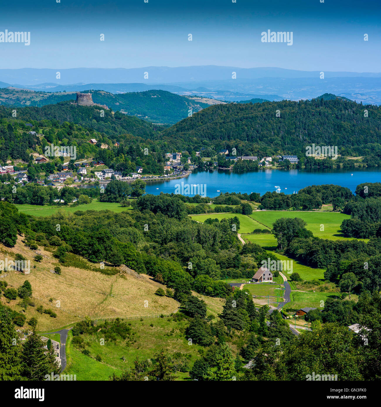 Lake Chambon and the castle of Murol in Puy de Dome, Auvergne, France - Stock Image