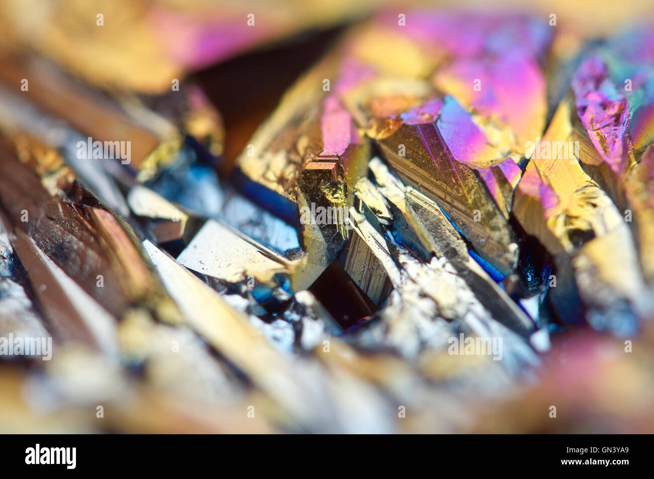Fantastic multi-coloured background from thin layer of the titan on a quartz surface Macro, for successful business Stock Photo