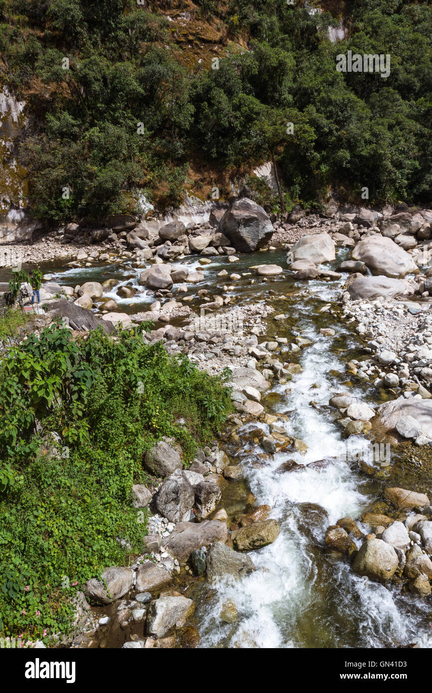 view of the river that run thru the Town of Machu Pichu with lots of rocks and large boulders - Stock Image