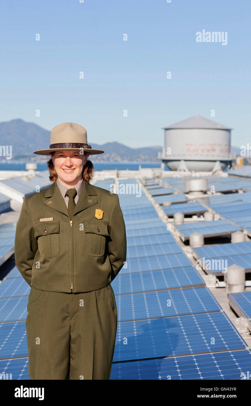 Portrait of Laura Castellini, the sustainability coordinator for the GGNRA in front of solar panels at Alcatraz - Stock Image