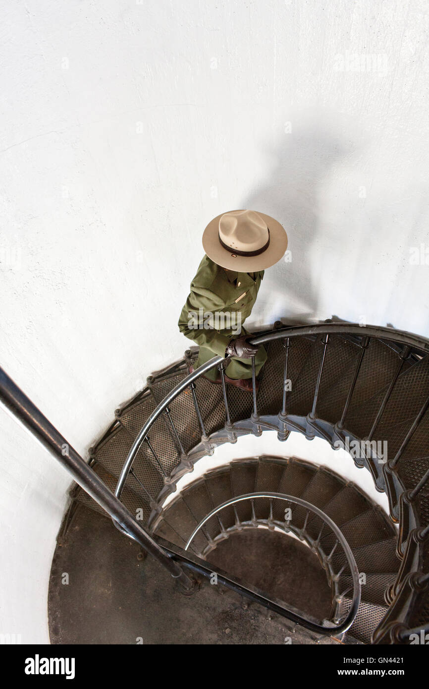 A park employee walks up the stairs of the lighthouse at Alcatraz Prison. San Francisco, California. - Stock Image