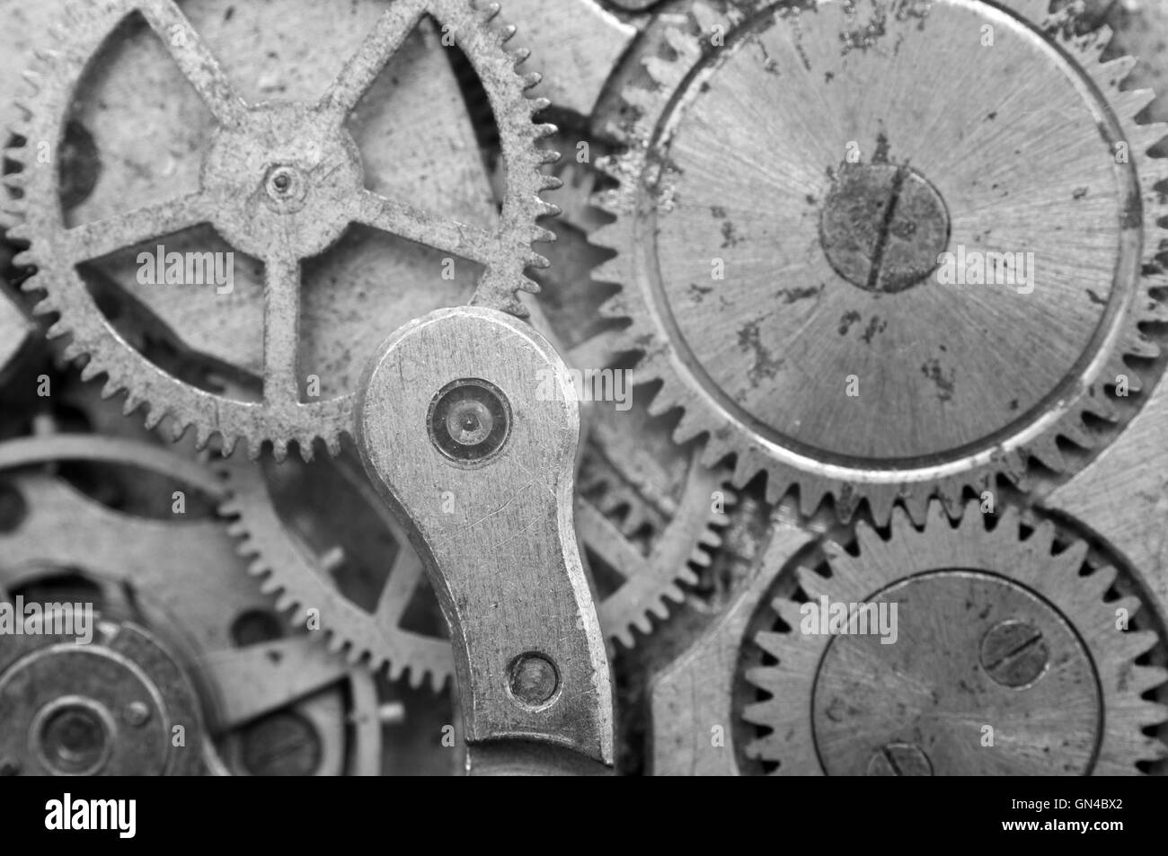 Black and white Metal Cogwheels in Oldest Rusty Clockwork, Macro. Concept Teamwork, Idea Technology - Stock Image