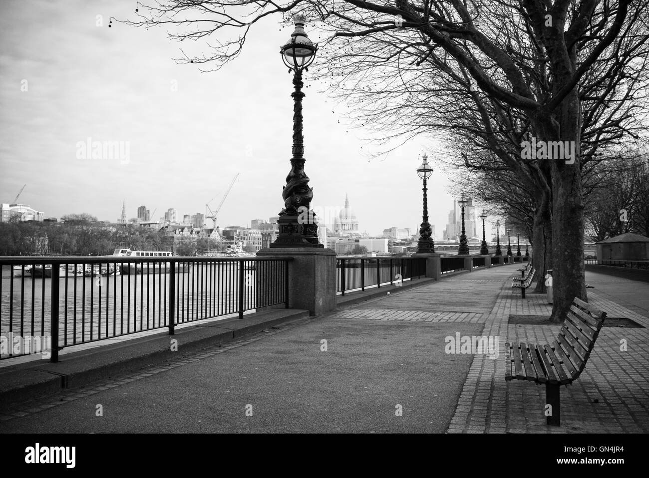 Southbank footpath, river thames,black and white - Stock Image
