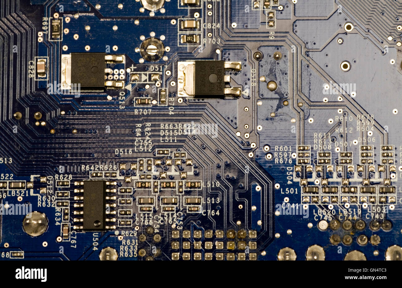 microcircuit with chip of condensers, resistors and transistors - Stock Image