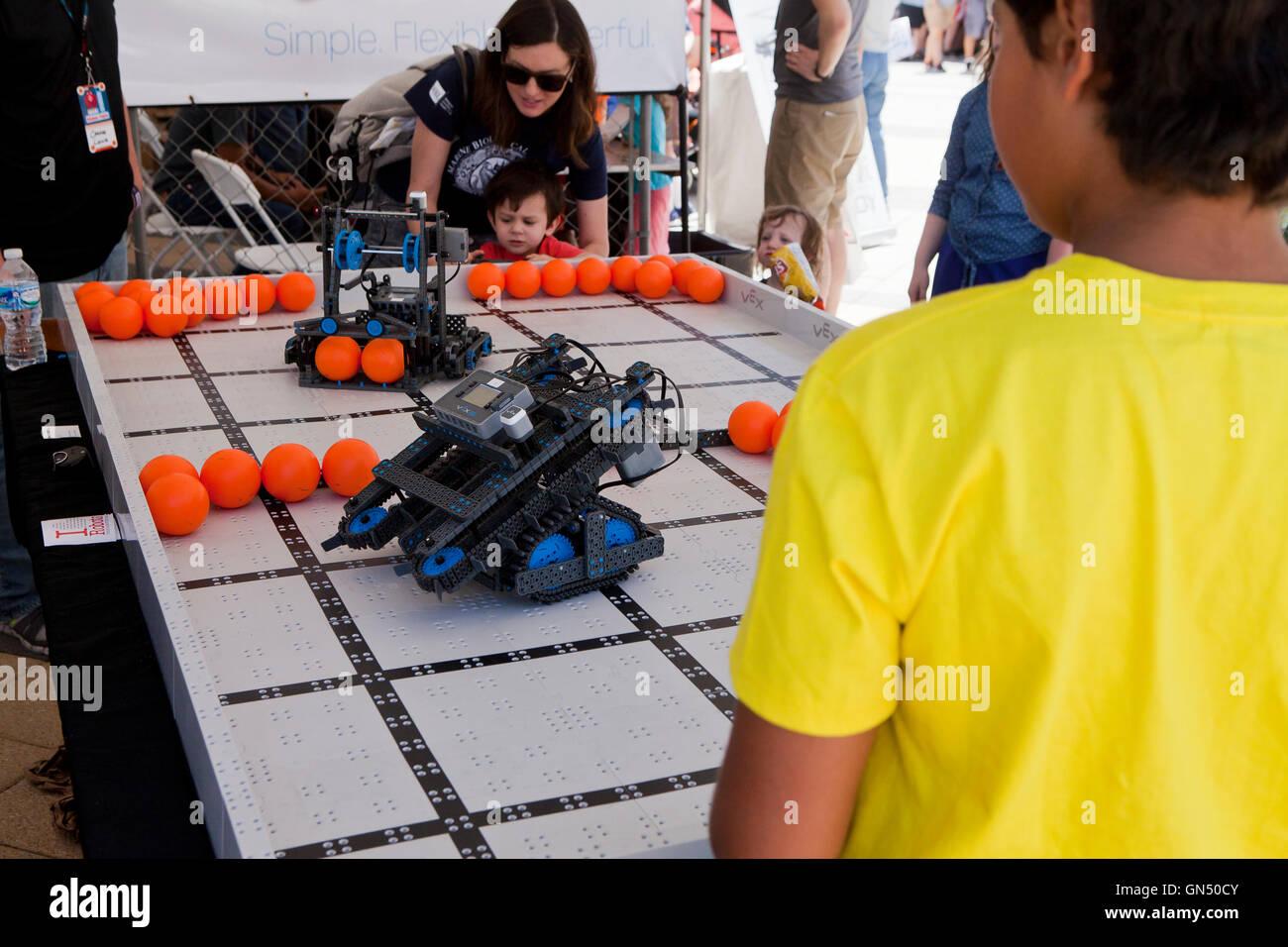 Schoolchild controlling a robot at Maker Faire - Washington, DC USA - Stock Image