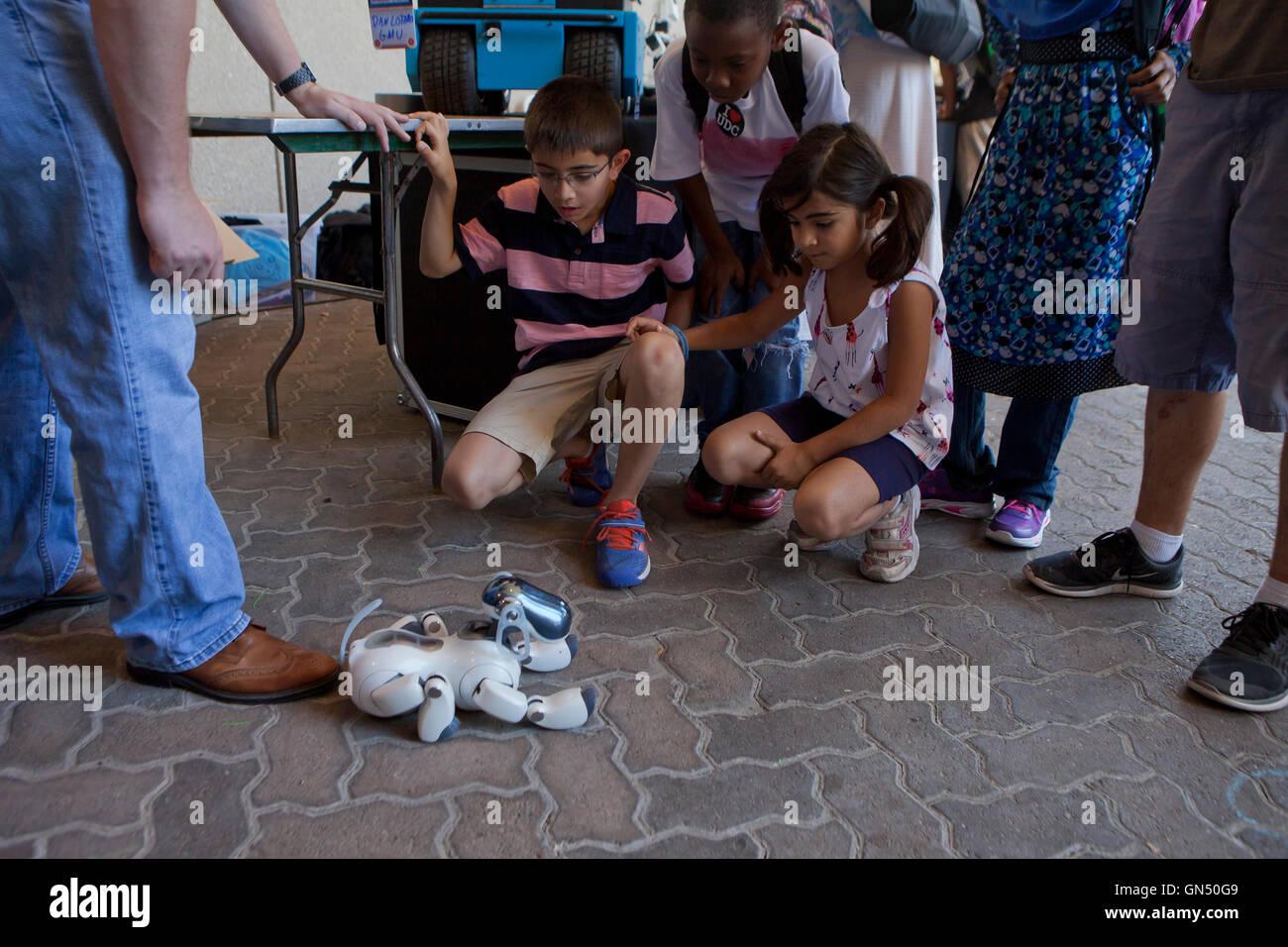 Schoolchildren learning about  robotics at Maker Faire - Washington, DC USA Stock Photo