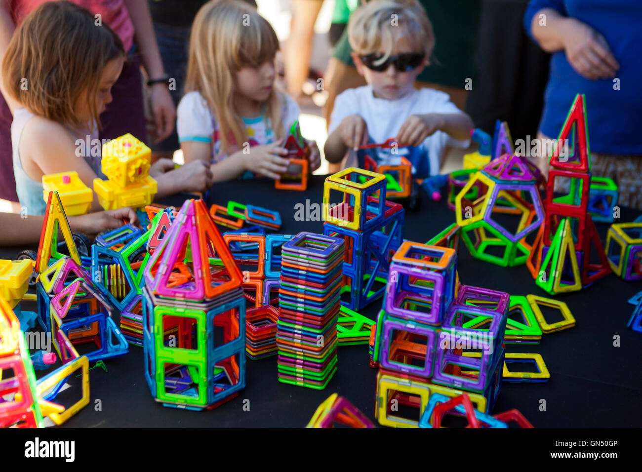 Children playing with Magformers magnetic building toy - USA - Stock Image