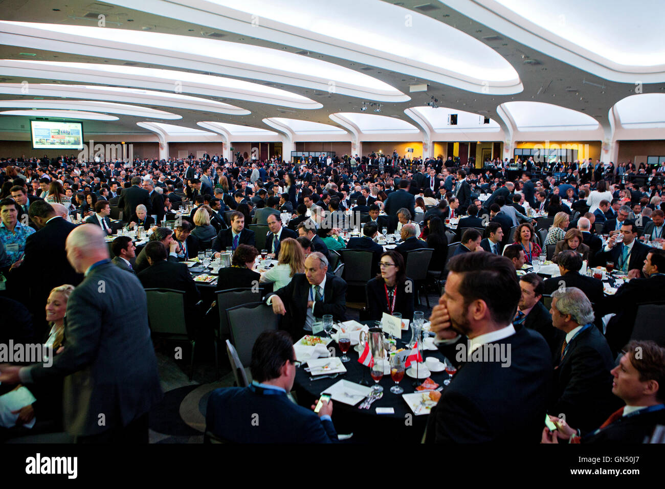 Guests seated at tables during an event in a large banquet room in the Hilton Hotel - Washington, DC  USA - Stock Image