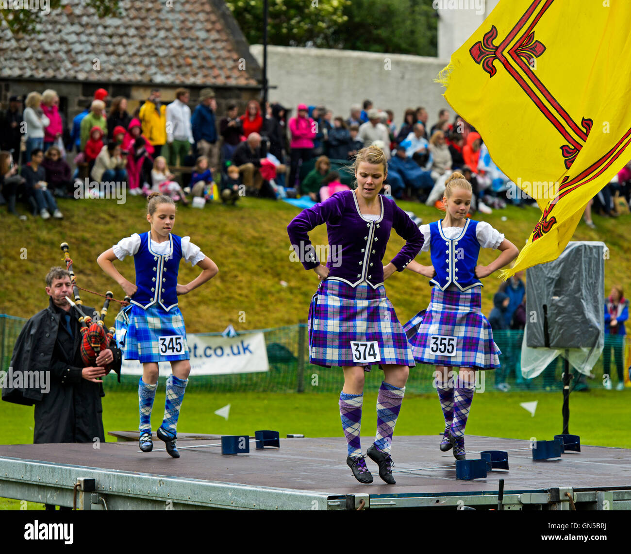 Girls in kilted skirts performing at the Highland Dancing competition, Ceres Highland Games, Ceres, Scotland, United - Stock Image