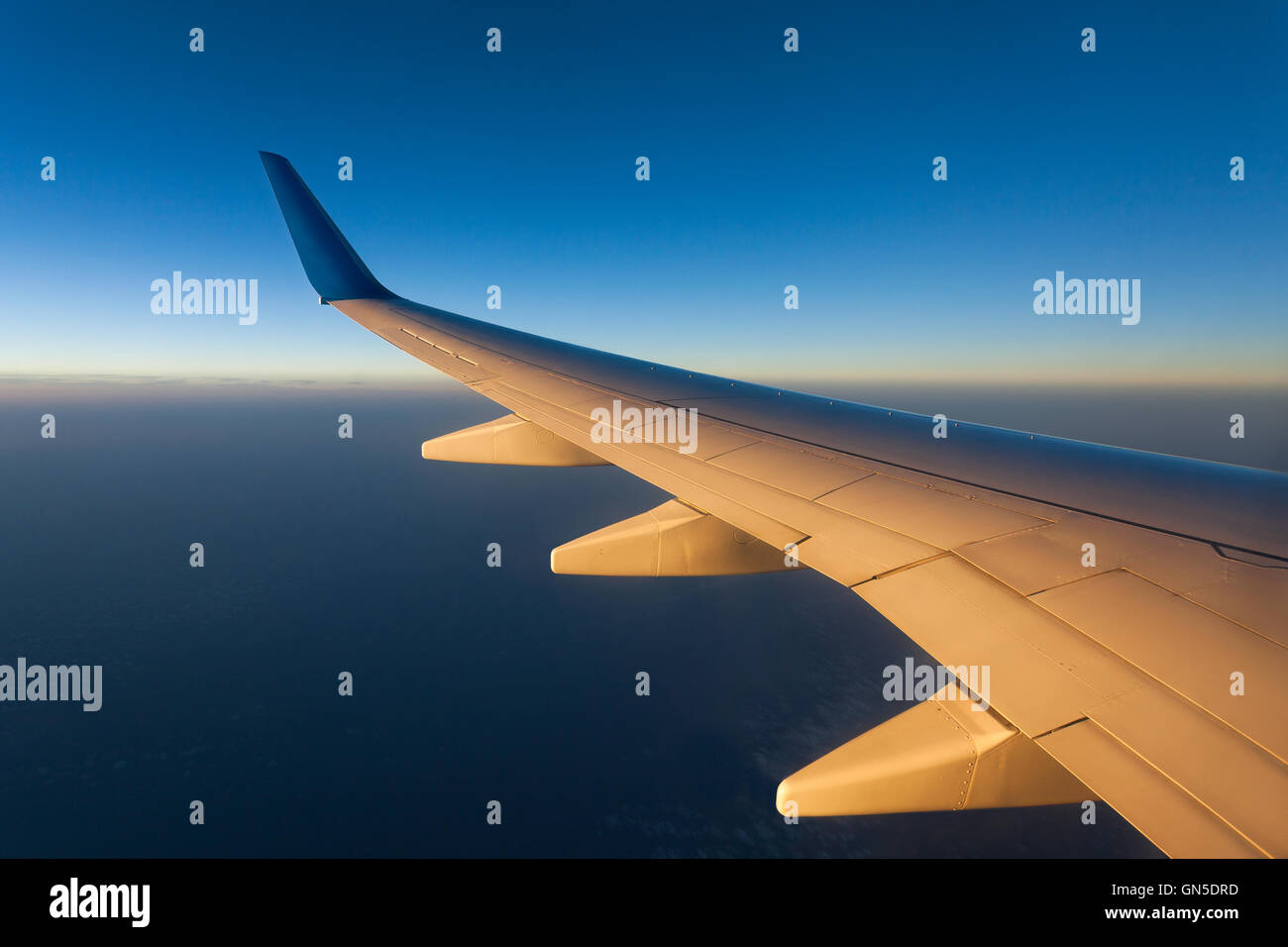 plane wing sunrise - Stock Image