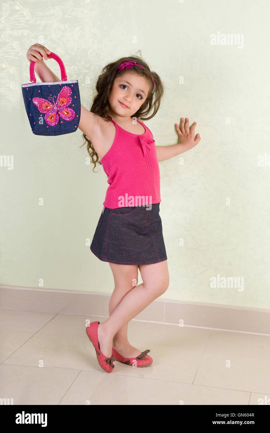 small girl with bag - Stock Image