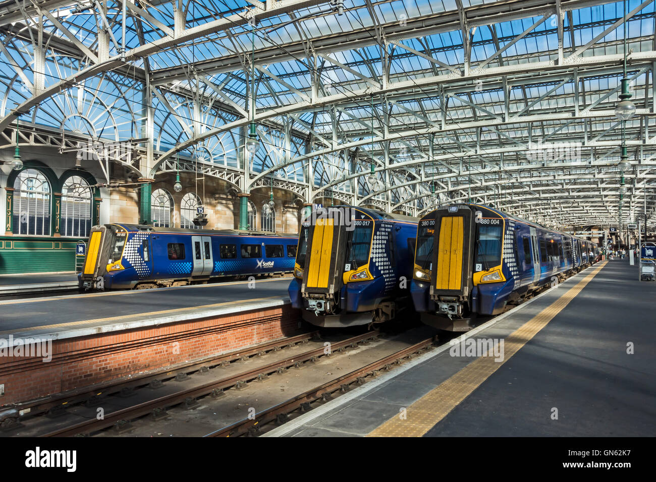 Three Class 380 EMU trains side by side in Glasgow Central Station Glasgow Scotland - Stock Image