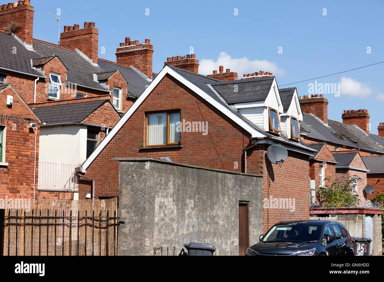 separate entrance to double storey house extension in the back of a row of terraced houses - Stock Image