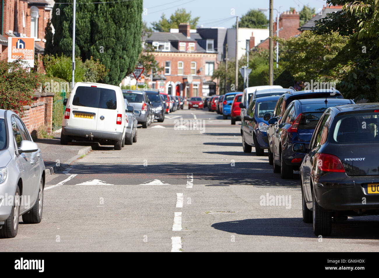 onstreet parking with speed bumps in a residential street in south belfast uk - Stock Image