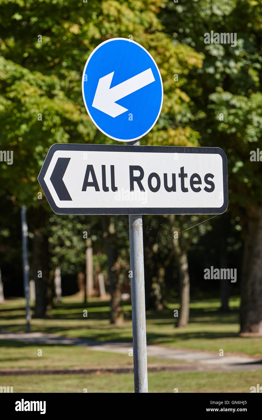 blue traffic direction arrow with all routes sign in the uk - Stock Image