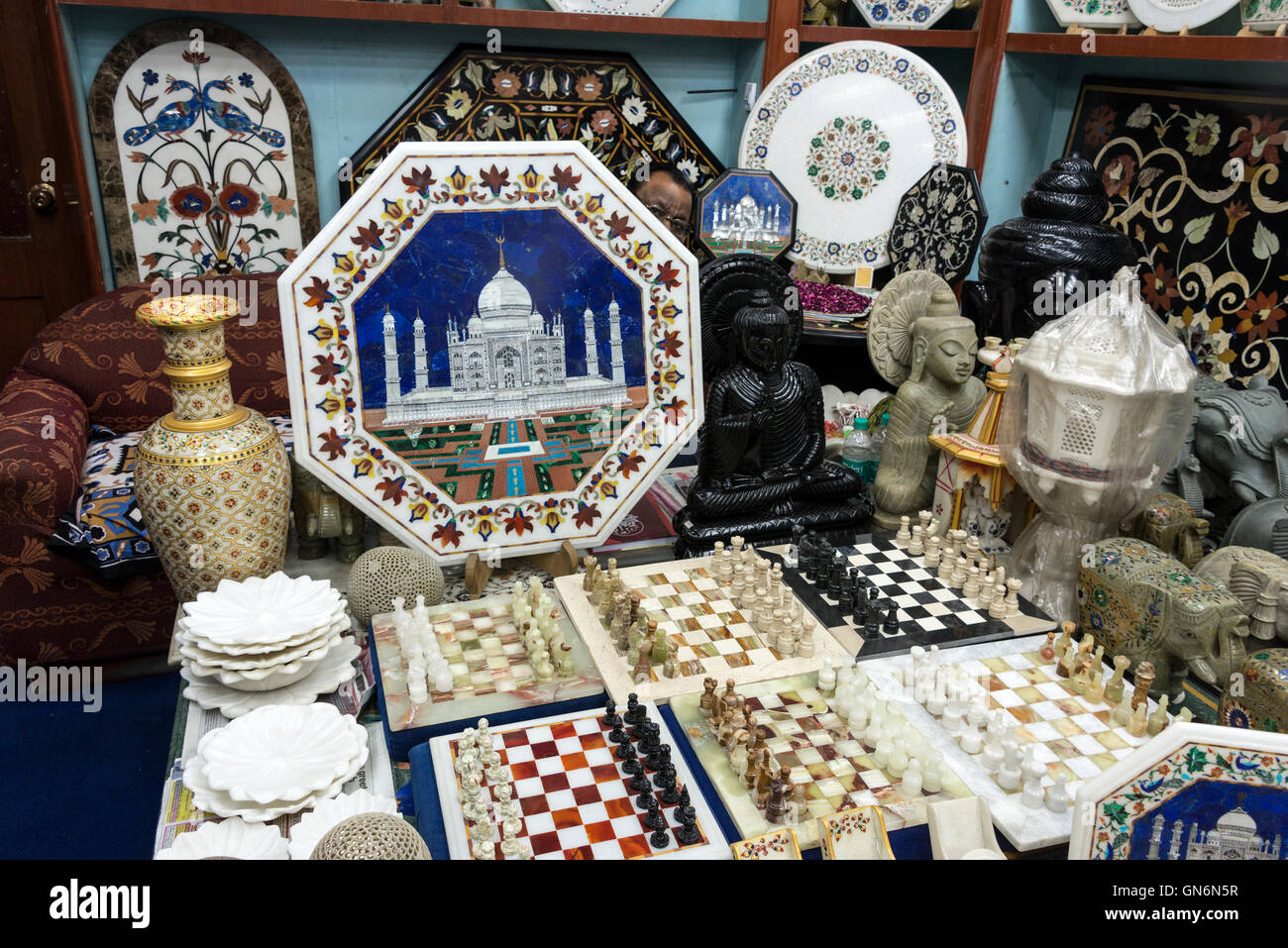 A shop display in Agra,Uttar Pradesh, India, of handmade table tops and furniture decorated with handmade highly - Stock Image