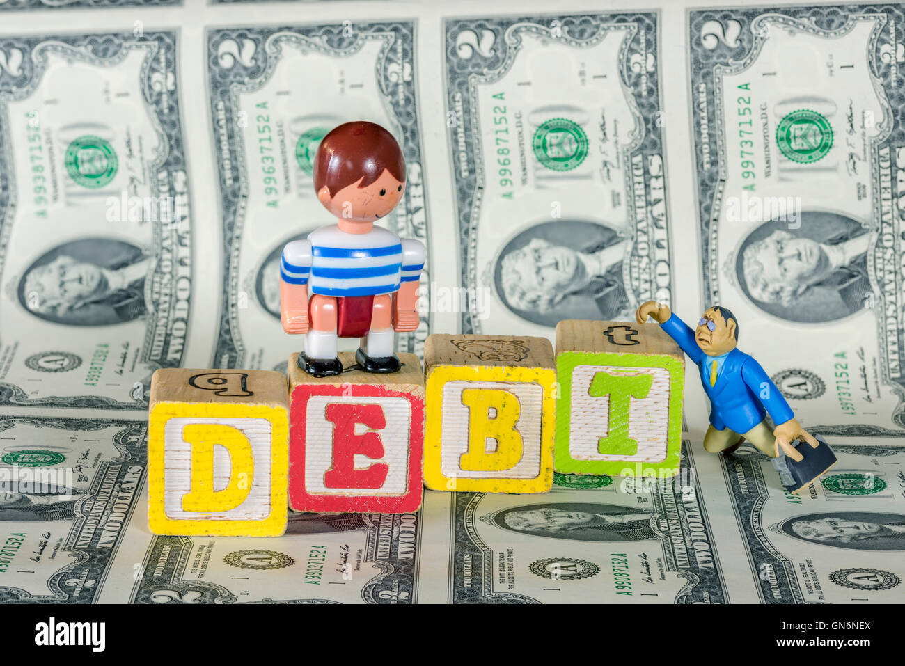 Children afordability with debt and money - Stock Image