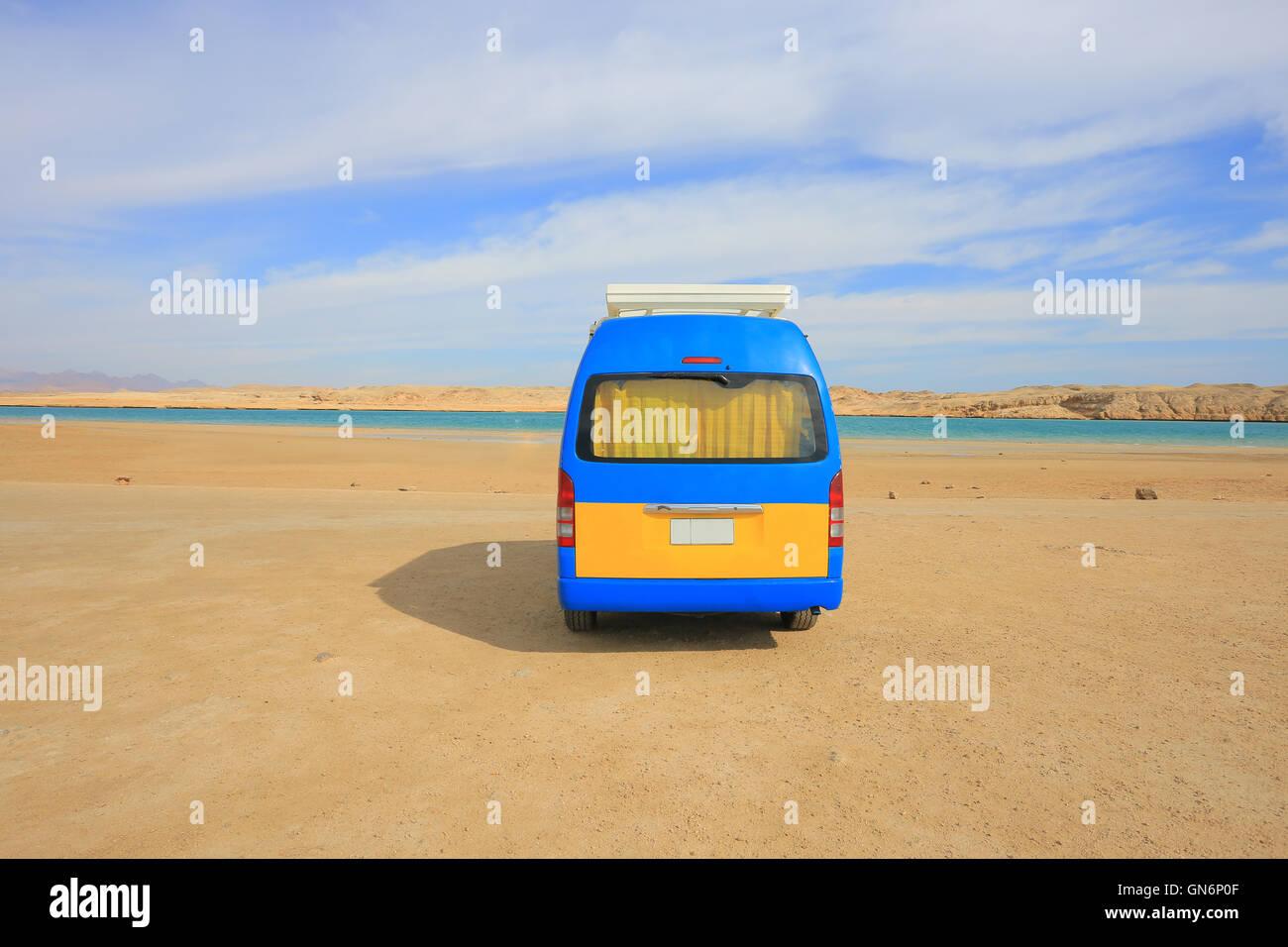 Minibus in the desert - Stock Image