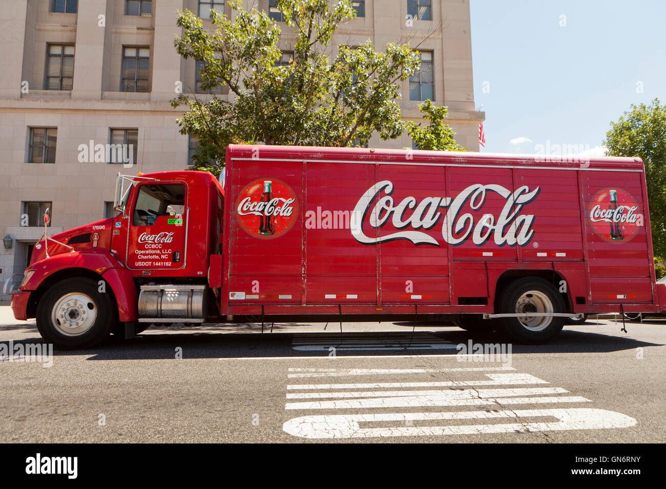 Coca-Cola delivery truck in front of office building - USA - Stock Image